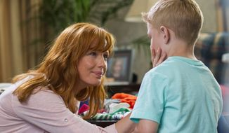 "Kelly Reilly and Connor Corum star in ""Heaven Is For Real."" The film, based on the best-selling book about a child's near-death experience, brought in $21.5 million at the box office in its opening weekend. (Sony Pictures via Associated Press)"