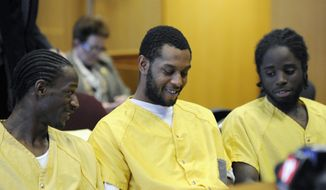 Defendants Wonzey Saffold, left, James Davis, center, and Latrez Cummings go before Judge Thomas Jackson, retired at Frank Murphy Hall of Justice, Monday, April 21, 2014, in Detroit. The four men who were accused of punching and kicking motorist, Steve Utash, who accidentally struck a 10-year-old Detroit boy, were ordered Monday to stand trial on attempted murder charges. (AP Photo/Detroit News, David Coates)  DETROIT FREE PRESS OUT; HUFFINGTON POST OUT