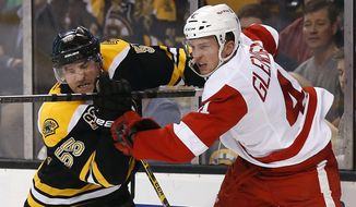 Boston Bruins defenseman Johnny Boychuk (55) collides with Detroit Red Wings' Luke Glendening during the first period of Game 2 of a first-round NHL hockey playoff series in Boston Sunday, April 20, 2014. (AP Photo/Winslow Townson)