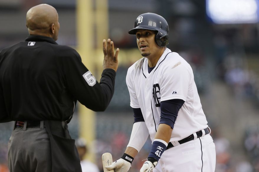Detroit Tigers designated hitter Victor Martinez argues a call with home plate umpire CB Bucknor during the first inning of a baseball game against the Chicago White Sox in Detroit, Monday, April 21, 2014. (AP Photo/Carlos Osorio)
