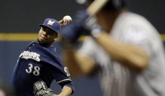 Milwaukee Brewers starting pitcher Wily Peralta throws to San Diego Padres' Will Venable during the first inning of a baseball game Monday, April 21, 2014, in Milwaukee. (AP Photo/Morry Gash)