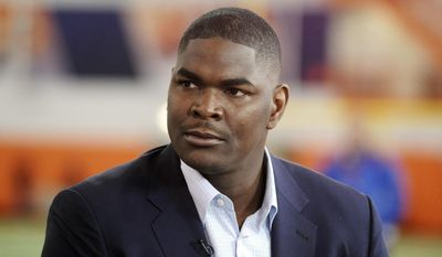 FILE - In this March 6, 2014, file photo, former NFL and Southern California receiver Keyshawn Johnson appears during the Clemson NCAA college football pro day in Clemson, S.C. The Los Angeles County Sheriff's Department says Johnson has been arrested after a report of a domestic dispute. A Sheriff's Department statement says deputies responded to a residence in Calabasas at 12:48 a.m. Monday, April 21, 2014, and determined the resident, subsequently identified as Johnson, and his ex-girlfriend were involved in a domestic dispute, and the resident was arrested for misdemeanor domestic battery. (AP Photo/Rainier Ehrhardt, File)