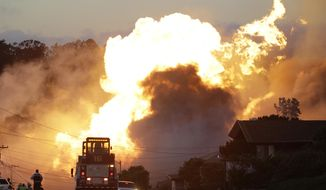 FILE - In this Sept. 9, 2010, file photo, a massive fire roars through a mostly residential neighborhood in San Bruno, Calif. Pacific Gas & Electric Co. pleaded not guilty Monday, April 21, 2014, to a dozen felony charges stemming from alleged safety violations in a deadly 2010 natural gas pipeline explosion that leveled a suburban neighborhood in the San Francisco Bay Area. As survivors of the blast looked on, attorneys for California's largest utility entered the plea in federal court in San Francisco to 12 felony violations of federal pipeline safety laws. (AP Photo/Paul Sakuma, File)