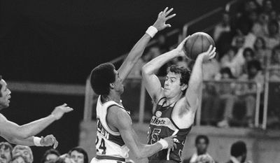 Washington Bullets' Kevin Grevey looks for help as Seattle's Dennis Johnson applies the defensive pressure during their NBA playoff game on Tuesday night, May 31, 1978 in Seattle's Kingdome. Washington won 120-116 in overtime to even their best of seven series for the NBA championship at two games each. Fifth game will be on Friday in Seattle. (AP Photo)