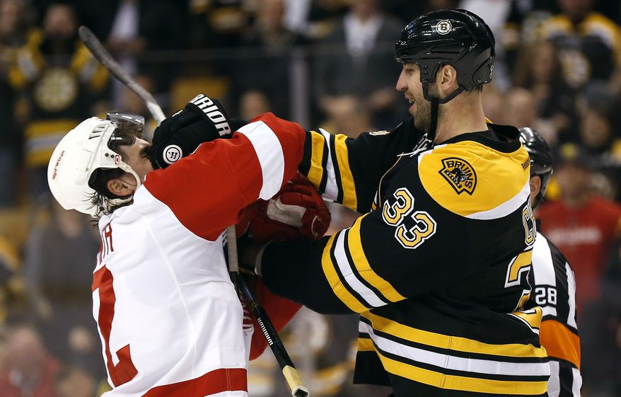 Boston Bruins' Zdeno Chara (33) mixes it up with Detroit Red Wings' Brendan Smith during the first period of Game 2 of a first-round NHL hockey playoff series in Boston, Sunday, April 20, 2014. (AP Photo/Winslow Townson)