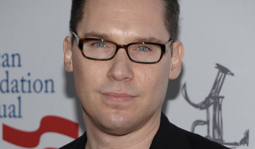 """FILE - In this March 3, 2012 file photo, director Bryan Singer arrives at the Los Angeles premiere of the play """"8"""" in Los Angeles. A man who sued Singer alleging the director sexually abused him in 1999 filed three lawsuits on Monday, April 21, 2014, against entertainment industry executives accusing them of molesting him in Hawaii on a trip in 1999.  (AP Photo/Dan Steinberg, file)"""