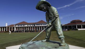 "The ""Putterboy"" statue is shown at Pinehurst Resort & Country Club during media day for the upcoming back-to-back U.S. Open and U.S. Women's Open golf championships to be held this June in Pinehurst, N.C., Monday, April 21, 2014. (AP Photo/Gerry Broome)"