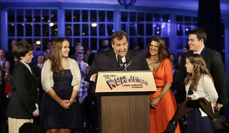FILE - In this Nov. 5, 2013 file photo, New Jersey Gov. Chris Christie greets a gathering, as he stands with his wife Mary Pat Christie, center right, and their children, Andrew, back right, Bridget, front right, Patrick, left, and Sarah, second left, in Asbury Park, N.J. It was announced on Monday, April 21, 2014, that Christie has been named a Father of the Year by the National Father's Day/Mother's Day Council. The Republican governor has four children ranging from ages 10 to 20. (AP Photo/Mel Evans, File)