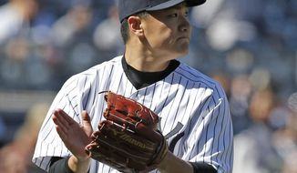 New York Yankees starting pitcher Masahiro Tanaka  reacts coming off the mound after pitching eight innings in the Yankees' 3-0 victory over the Chicago Cubs in the afternoon game of an interleague baseball day-night doubleheader at Yankee Stadium in New York, Wednesday, April 16, 2014. (AP Photo/Kathy Willens)