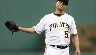 Pittsburgh Pirates starting pitcher Wandy Rodriguez (51) gets the ball back after giving up a double to Milwaukee Brewers' Jean Segura in the third inning of a baseball game Saturday, April 19, 2014, in Pittsburgh. (AP Photo/Keith Srakocic)