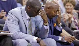 FILE - In this April 14, 2014, file photo, Utah Jazz's head coach Tyrone Corbin, left, lowers his head late in the fourth quarter during an NBA basketball game against the Los Angeles Lakers, in Salt Lake City, Utah. The Jazz announced Monday, April 21, 2014, that the team won't be offering Corbin a new contract. (AP Photo/Rick Bowmer, File)