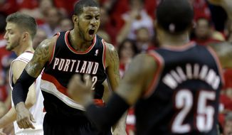 Portland Trail Blazers' LaMarcus Aldridge (12) reacts after making a basket while being fouled during the fourth quarter in Game 1 of an opening-round NBA basketball playoff series against the Houston Rockets  Sunday, April 20, 2014, in Houston. The Trail Blazers won 122-120 in overtime. (AP Photo/David J. Phillip)