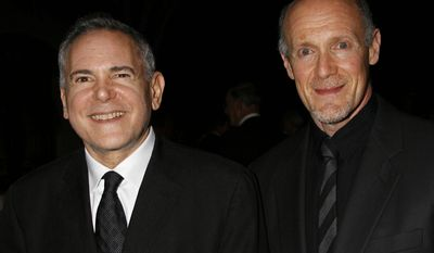 "FILE - This Nov. 15, 2007 file photo shows Craig Zadan, left, and Neil Meron, producers of the film ""Hairspray"" at the Santa Barbara International Film Festival's Kirk Douglas Award for Excellence in Film presented to actor John Travolta in Santa Barbara, Calif. The producers behind the last two Oscar telecasts are coming back for a third time. The film academy announced Monday, April 21, 2014, that Zadan and Meron will return to produce the 87th annual Academy Awards held on Feb. 22, 2015.  (AP Photo/Michael A. Mariant, file)"