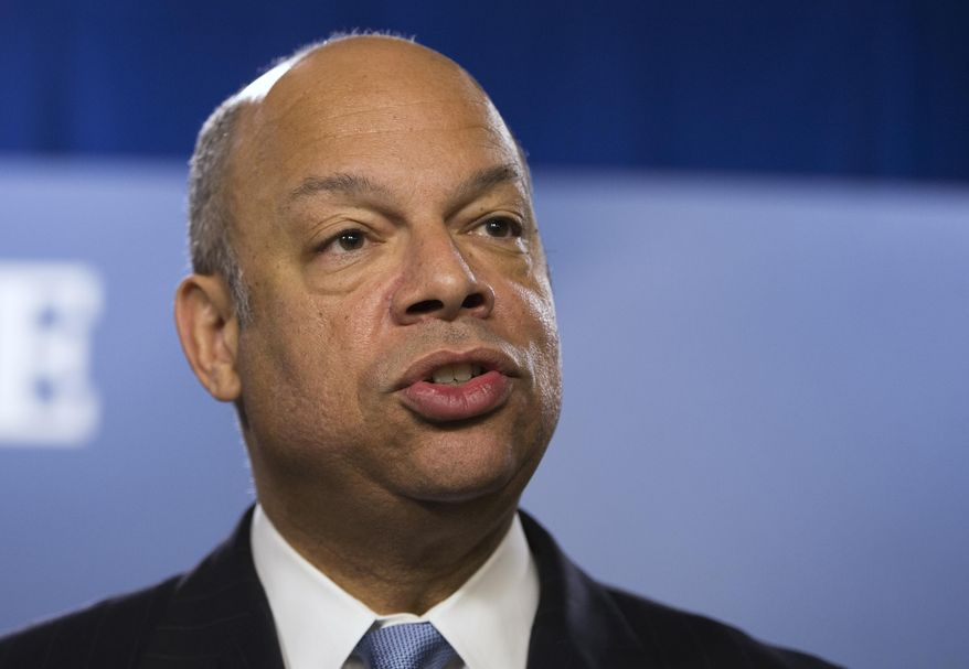 FILE - This March 18, 2014 file photo shows Homeland Security Secretary Jeh Johnson speaking in Washington. Reviewing the U.S. deportation policy, Homeland Security Secretary Jeh Johnson is said to be weighing limiting deportations of immigrants living here illegally but without serious criminal records. The change could shield tens of thousands of immigrants now deported because of repeated violations such as disobeying a deportation order or missing a court date. (AP Photo/ Evan Vucci, File)