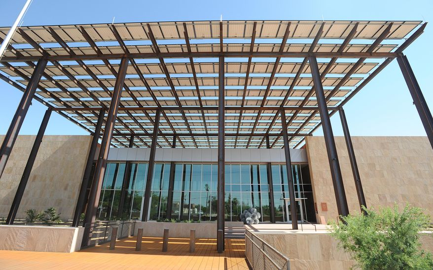 This June 7, 2013 photo shows the new John M. Roll U.S. Courthouse in Yuma, Ariz. The courthouse, named after Judge John Roll, one of the six people killed in the Tucson shooting rampage, will be dedicated Thursday, April 24, 2014. (AP Photo/The Yuma Sun, Randy Hoeft)
