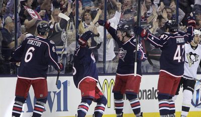 Columbus Blue Jackets' Nikita Nikitin, left to right, of Russia, Boone Jenner, Ryan Johansen and Dalton Prout celebrate their goal against the Pittsburgh Penguins during the first period of a first-round NHL playoff hockey game Monday, April 21, 2014, in Columbus, Ohio. (AP Photo/Jay LaPrete)