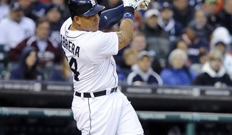 Detroit Tigers' Miguel Cabrera follows through on a two-run home run to right field during the third inning of a baseball game against the Chicago White Sox in Detroit on Tuesday, April 22, 2014. (AP Photo/Lon Horwedel)