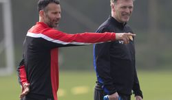 "FILE - In this Monday, March 31, 2014 file photo Manchester United's manager David Moyes, right, stands alongside Ryan Giggs as the team trains at Carrington training ground in Manchester. Manchester United says manager David Moyes has left the Premier League club after less than a year in charge, amid heavy speculation he was about to be fired. United released a brief statement in its website Tuesday, saying the club ""would like to place on record its thanks for the hard work, honesty and integrity he brought to the role."" Giggs has been tipped to takeover on an interim basis. (AP Photo/Jon Super, File)"