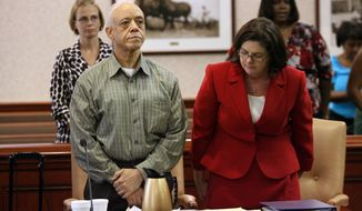 FILE - In this Sept, 10, 2009, file photo,Von Clark Davis, left, with his attorney Melynda Cook-Reich stand before a three-judge panel  in Hamilton, Ohio, that sentenced him to return to Ohio's Death Row. The Ohio Supreme Court has upheld the death sentence of Davis who fatally shot his girlfriend three decades ago while on parole for killing his wife. (AP Photo/Hamilton Journal News, Nick Daggy, File) MAGS OUT