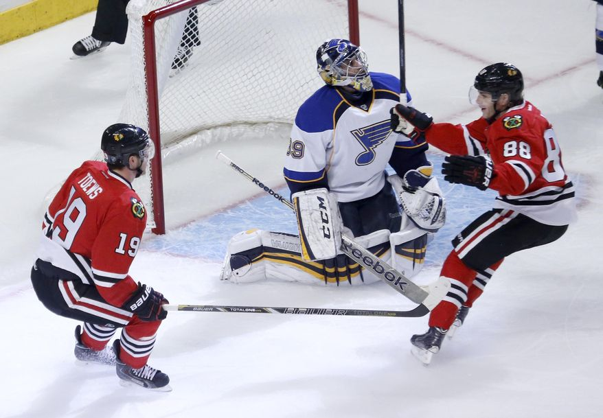 Chicago Blackhawks center Jonathan Toews, left, and Patrick Kane, right, celebrate Toews's goal in front of St. Louis Blues goalie Ryan Miller during the first period in Game 3 of a first-round NHL hockey Stanley Cup playoff series game Monday, April 21, 2014, in Chicago. (AP Photo/Charles Rex Arbogast)