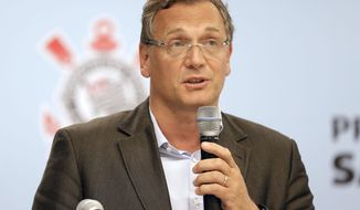 FIFA Secretary General Jerome Valcke speaks during a news conference after inspecting the unfinished Itaquerao stadium in Sao Paulo, Brazil, Tuesday, April 22, 2014. The stadium will host the World Cup opener match between Brazil and Croatia in June. (AP Photo/Andre Penner)