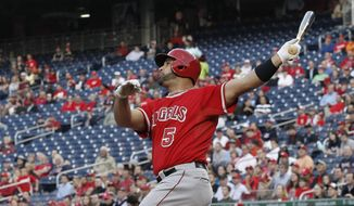 Los Angeles Angels Albert Pujols watches his three-run homer, against Washington Nationals starting pitcher Taylor Jordan, clear the fence during the first inning of a baseball game, Tuesday, April 22, 2014. This was Pujols 499th home run of his career. (AP Photo/Pablo Martinez Monsivais)