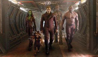 "This image released by Disney - Marvel shows, from left, Zoe Saldana, the character Rocket Racoon, voiced by Bladley Cooper, Chris Pratt, the character Groot, voiced by Vin Diesel and Dave Bautista in a scene from ""Guardians Of The Galaxy."" (AP Photo/Disney - Marvel)"