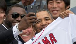 "President Obama feigned outrage when it became public that the picture of him with Boston Red Sox slugger David Ortiz and a ""44"" jersey was just part of some sleazy corporate product campaign by Samsung. (Associated Press)"