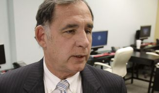 """FILE - This May 31, 2011 file photo shows Sen. John Boozman, R-Ark. in his Senate office in Little Rock, Ark. Boozman is undergoing surgery at an Arkansas hospital. Boozman's office issued only a brief statement Tuesday morning saying the Republican """"is receiving excellent care."""" Boozman's staff wouldn't say what type of surgery the 62-year-old senator is having but that more information will be released later. (AP Photo/Danny Johnston, File)"""