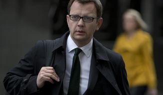 Andy Coulson, former former editor of the now closed News of the World newspaper arrives at the Central Criminal Court, the Old Bailey, in London where she appears to face charges related to phone hacking Tuesday, April, 22, 2014. (AP Photo/Alastair Grant)