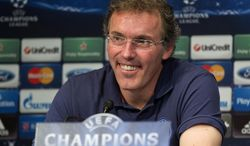 FILE - This is a Wednesday, April 2, 2014 file photo of Paris Saint Germain's coach Laurent Blanc, as he smiles during press conference prior to a training session at Parc des Princes stadium in Paris .  Blanc is one of the  potential full-time replacements for David Moyes as Manchester United manager after his firing on Tuesday, April 22, 2014. (AP Photo/Michel Euler, File)