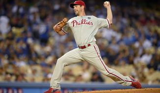 Philadelphia Phillies starting pitcher Cliff Lee throws to the plate during the first inning of a baseball game against the Los Angeles Dodgers, Monday, April 21, 2014, in Los Angeles. (AP Photo/Mark J. Terrill)