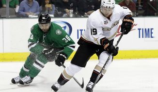 Anaheim Ducks' Stephane Robidas (19) handles the puck as Dallas Stars' Vernon Fiddler (38) gives chase in the first period of Game 3 of a first-round NHL hockey Stanley Cup playoff series game, Monday, April 21, 2014, in Dallas. (AP Photo/Tony Gutierrez)