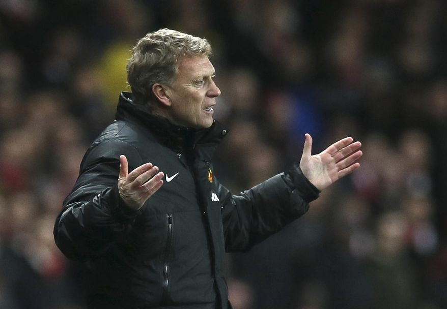 "FILE - In this Wednesday, Feb. 12, 2014 file photo Manchester United's manager David Moyes gestures to his team during their English Premier League soccer match between Arsenal and Manchester United at the Emirates stadium in London. Manchester United says manager David Moyes has left the Premier League club after less than a year in charge, amid heavy speculation he was about to be fired. United released a brief statement in its website Tuesday, saying the club ""would like to place on record its thanks for the hard work, honesty and integrity he brought to the role."" (AP Photo/Alastair Grant, File)"