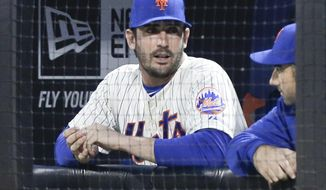 New York Mets starting pitcher Matt Harvey talks to a teammate before a baseball game against the St. Louis Cardinals Tuesday, April 22, 2014, in New York. The picture Harvey tweeted of himself making an obscene gesture on his way into surgery caused such a stir that the injured New York Mets ace has shut down his Twitter account. (AP Photo/Frank Franklin II)