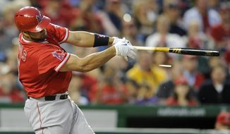 Los Angeles Angels' Albert Pujols splinters his bat as he grounds out into a double-play during the third inning of a baseball game against the Washington Nationals, Monday, April 21, 2014, in Washington. (AP Photo/Nick Wass)