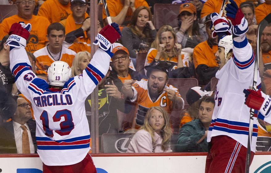 New York Rangers' Daniel Carcillo, left, celebrates his goal as he faces with fans with Brian Boyle, right, coming to him during the third period in Game 3 of an NHL hockey first-round playoff series, Tuesday, April 22, 2014, in Philadelphia. The Rangers won 4-1. (AP Photo/Chris Szagola)