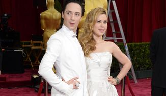 FILE - This March 2, 2014 file photo shows Johnny Weir, left, and Tara Lipinski at the Oscars in Los Angeles. NBC is adding Johnny Weir and Tara Lipinski as fashion correspondents on its Kentucky Derby coverage next week, further evidence of how the network's coverage is reflecting one of the most female-friendly televised sporting events of the year. (Photo by Dan Steinberg/Invision/AP, File)