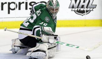 Dallas Stars goalie Kari Lehtonen (32) of Finland defends against a shot by the Anaheim Ducks in the second period of Game 3 of a first-round NHL hockey Stanley Cup playoff series game, Monday, April 21, 2014, in Dallas. (AP Photo/Tony Gutierrez)