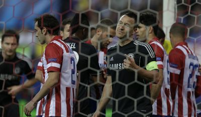 Chelsea's John Terry, gestures as his teams goalkeeper Petr Cech is treated due to injury during the Champions League semifinal first leg soccer match between Atletico Madrid and Chelsea at the Vicente Calderon stadium in Madrid, Spain, Tuesday, April 22, 2014 .Chelsea goalkeeper Petr Cech was taken off injured and replaced by goalkeeper Mark Schwarzer.(AP Photo/Paul White)