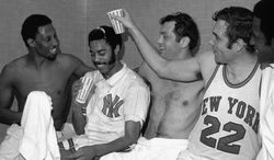 Dave DeBusschere (22) pours beer over Walt Frazier after the New York Knickers Bocker players beat the Milwaukee Ducks 132-96 in Madison Square Garden April 20,1970 putting them into the NBA Championship playoffs. Others are, Bill Bradley, center, and Cazzie Russel right. (AP Photo)