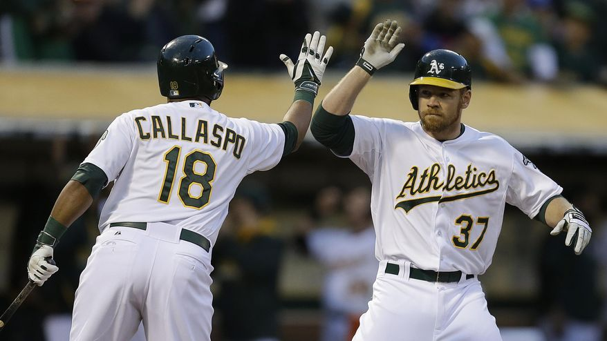 Oakland Athletics' Alberto Callaspo, left, congratulates Brandon Moss (37) after Moss ht a home run off Texas Rangers' Yu Darvish  in the second inning of a baseball game Monday, April 21, 2014, in Oakland, Calif. (AP Photo/Ben Margot)