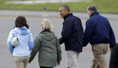 President Barack Obama, accompanied by, from left, Sen. Maria Cantwell, D-Wash., Sen. Patty Murray, D-Wash., and Washington Gov. Jay Inslee, walks toward Marine One at Paine Field in Everett, Wash., Tuesday, April 22, 2014, after the president arrived on Air Force One, and before traveling to the community of Oso, Wash., which was hit by a deadly mudslide on March 22, 2014. (AP Photo/Ted S. Warren)