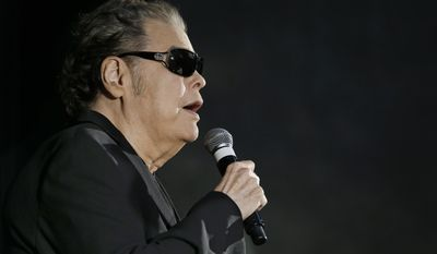 Ronnie Milsap speaks after he was introduced as one of three new inductees into the Country Music Hall of Fame Tuesday, April 22, 2014, in Nashville, Tenn. Milsap was elected along with Mac Wiseman and the late Hank Cochran. (AP Photo/Mark Humphrey)