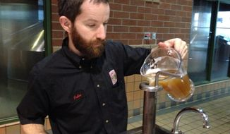 ** FILE ** In this April 18, 2014, photo, John Eaton, brewing manager at Widmer Brothers in North Portland, Ore., works on a morning batch at the brewery. (AP Photo/The Oregonian, Lynne Terry)