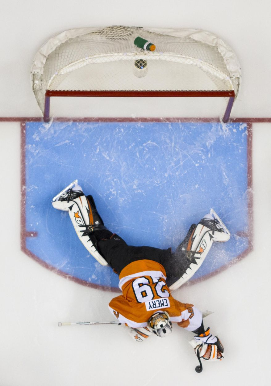 Philadelphia Flyers' Ray Emery reaches for the puck during the third period in Game 3 of an NHL hockey first-round playoff series against the New York Rangers, Tuesday, April 22, 2014, in Philadelphia. The Rangers won 4-1. (AP Photo/Chris Szagola)