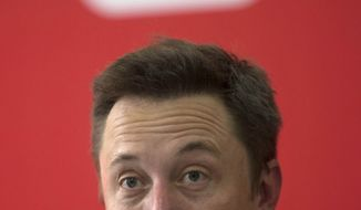 Tesla Motors Inc. CEO Elon Musk speaks before an event to deliver the first set of sedans to customers in Beijing, China, Tuesday, April 22, 2014. Tesla Motors delivered its first eight electric sedans to customers in China on Tuesday and Musk  said the company will build a nationwide network of charging stations and service centers as fast as it can. (AP Photo/Ng Han Guan)