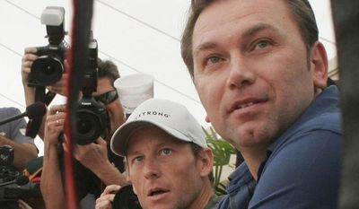 FILE - This is a Thursday, Dec. 4, 2008 file photo of U.S. cyclist Lance Armstrong, left, and Astana team director Johan Bruyneel. right, as they attend a news conference in Los Cristianos, on the Canary Island of Tenerife, Spain. Lance Armstrong's longtime coach Johan Bruyneel was banned for 10 years Tuesday April 22, 2014  for helping organize widespread doping by the former seven-time Tour de France winner's cycling teams. (AP Photo/Arturo Rodriguez, File)