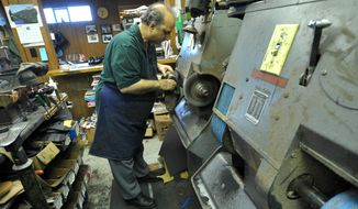 ADVANCED FOR RELEASE SATURDAY, APRIL 26, 2014 Ray Torcaso works on a pair of shoes at his shop, Torcaso Shoe Repair, in Kenosha, Wis. (AP Photo/Kenosha News, Sean Krajacic)