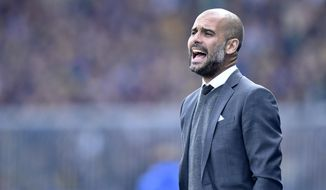 Bayern head coach Pep Guardiola of Spain shouts to his team during the German Bundesliga soccer match between Eintracht Braunschweig and Bayern Munich in Braunschweig, Germany, Saturday, April 19, 2014. (AP Photo/Martin Meissner)